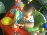 Playing in Exersaucer!