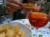 In Italy drinking spritz & eating crisps