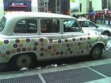 No idea why this was on the corner of 27th and 7th, but this car is painted with multicolored NYC subway tokens, in the old cuto