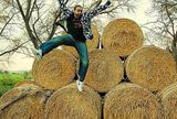 UK: Children with beards jumping off hay bales