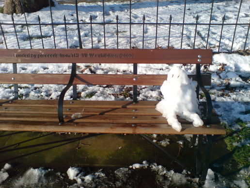 Snow kid on bench - kew green