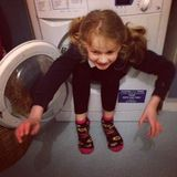 My gorgeous (not so) little Beasty with her tush stuck in the washer.