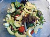 Mixed leaf, avocado, tomato and pine nut salad