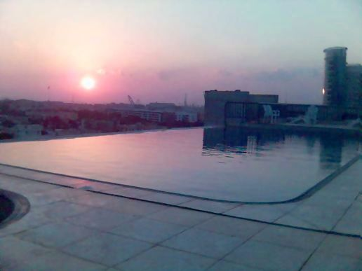 The rooftop pool at sunset