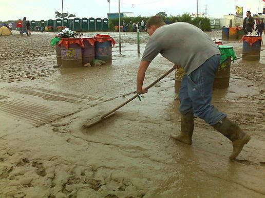 http://moblog.net/media/g/r/e/greenpeaceuk/sweeping-mud.jpg