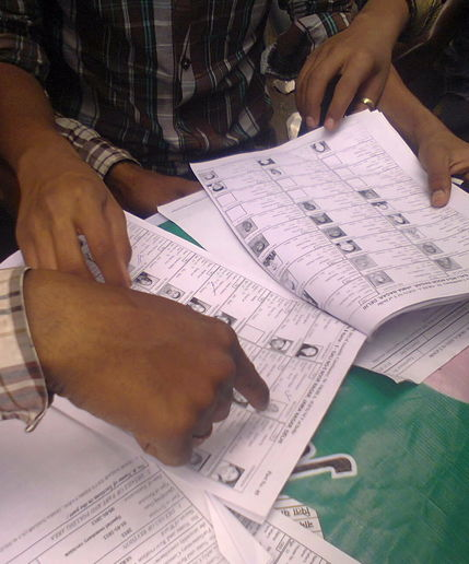 15.4.12 Voters checking their names Voters list.