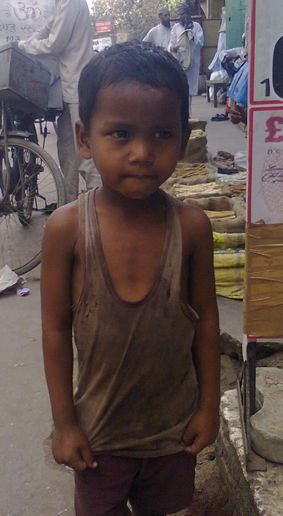 Muddassir Ahmed, 5, a street child gives a pose on request.