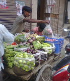 Aziz vegetable vendor.