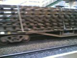 Meta: sleepers and rails being transported by train
