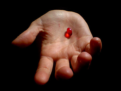 Hand with red pill