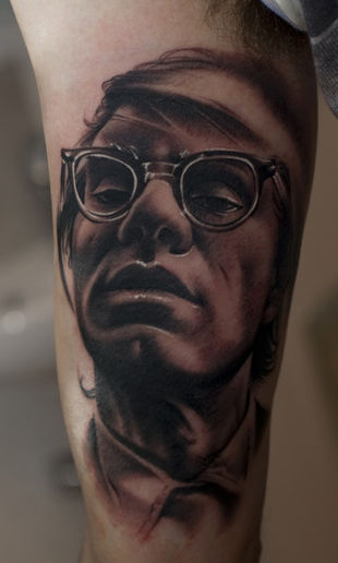 B&W; Portrait of Andy Warhol placed on my inner bicep. Tattooed by Piotrek