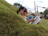 paper reading on the grass sofa