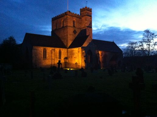 Church in Stroud illuminated at night.