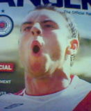 Why would a football club want a picture of a man climaxing on the front cover of it's magazine?