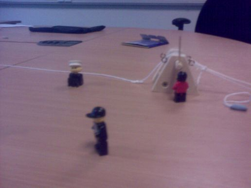 Lego men build a radio mast
