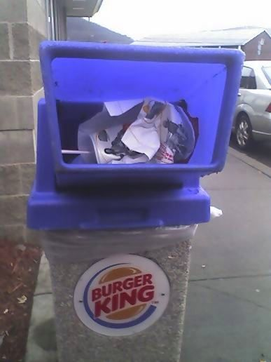Burger King can topped off with McDonalds garbage