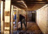 Opening up the cow stalls which will be hall, bedrooms and bathroom