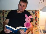 Daddy and Piglet enjoy a book