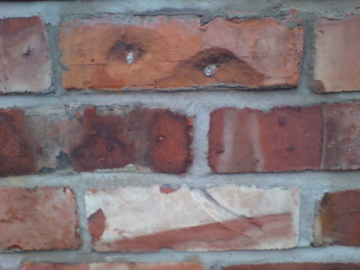 Face in the wall
