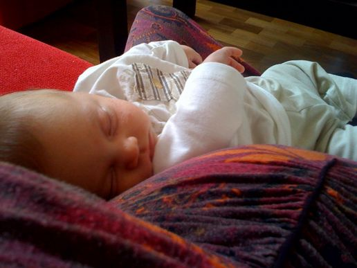Baby resting on a baby