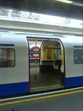 Tube train with doors open on both sides