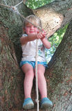 Allison climbs the tree