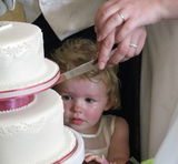more reception pics - cutting the cake - daughter has to be in on the act!
