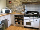The new kitchen - stone wall and door wall