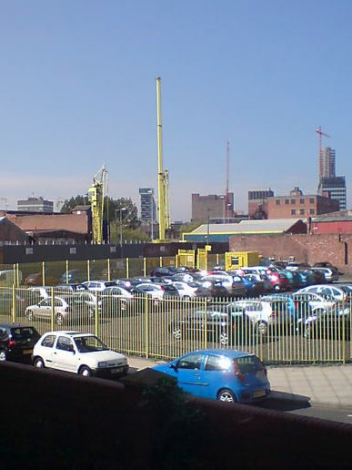 Big cranes and shiny cars