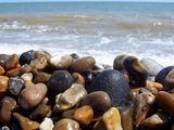 The pebbles were dragged gently with the waves...